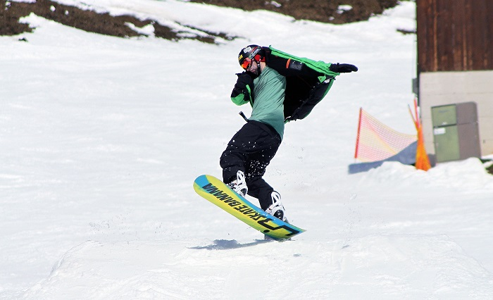 guy riding snowboard
