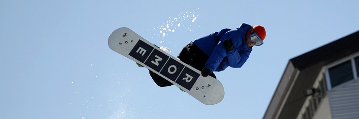 guy jumping with snowboard