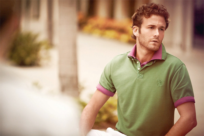 man with green and pink polo shirt