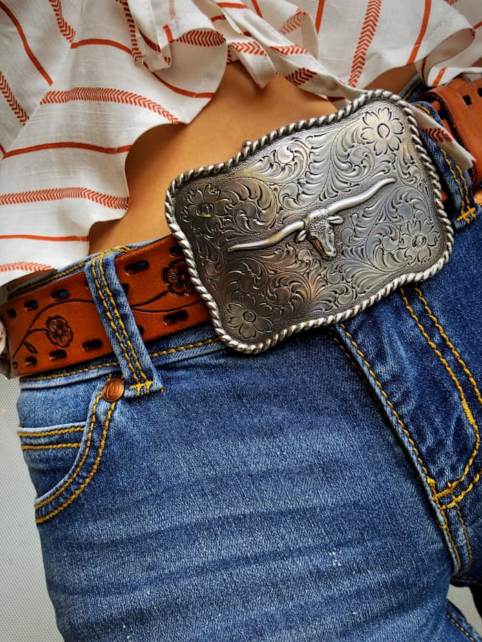 girl wearing jeans with country belt