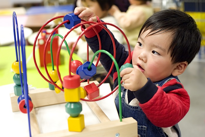 picture of a kid playing with an educational toy
