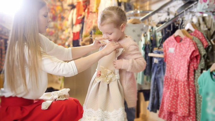 girl-with-mom-buying-dress