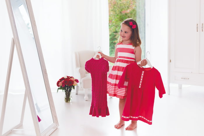 little-girl-choosing-dress