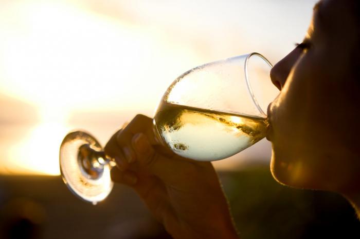 A Women Drinking White Wine